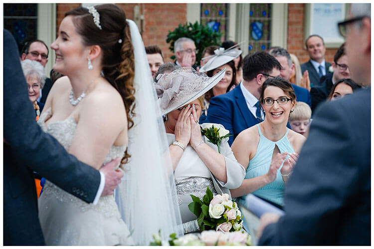 Parent holds back tears during Kilworth House wedding ceremony