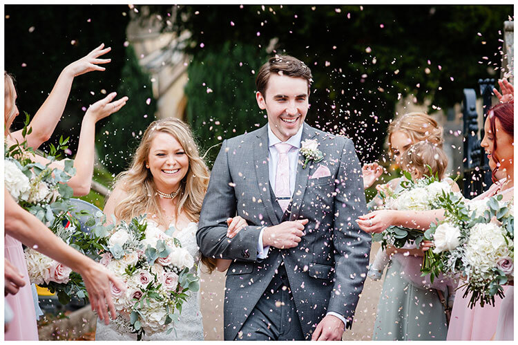 bridesmaids throw confetti at happy bride and groom favourite wedding photography 2018