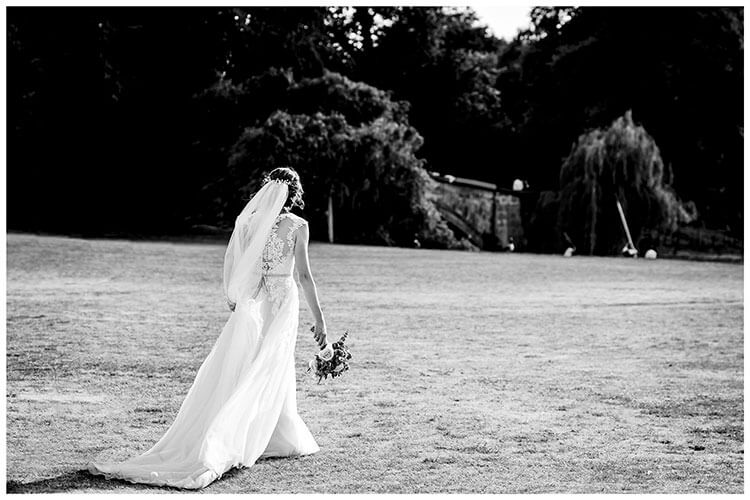 Bride at Kings college Cambridge walking holding bouquet favourite wedding photography 2018