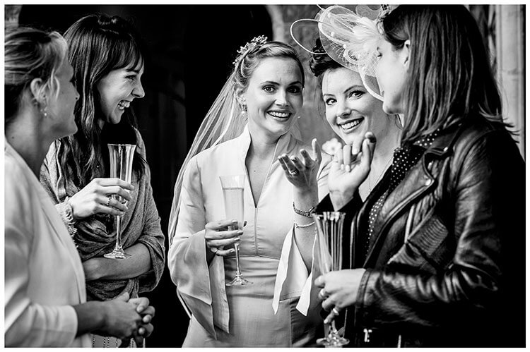 Bride and female friends enjoying a laugh favourite wedding photography 2018