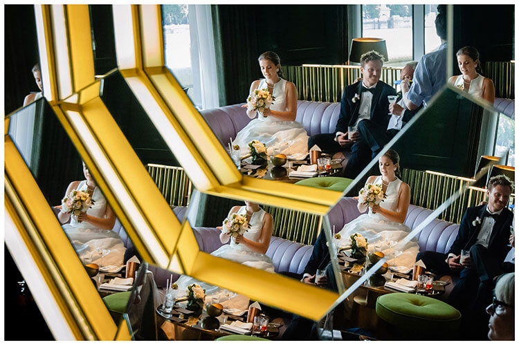Bride groom reflected multiple time in mirror whilst sat in Seacontainers bar in London favourite wedding photography 2018