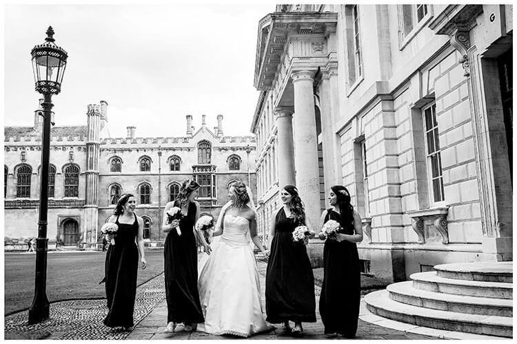 Bride and Bridesmaids walking and laughing at Kings College Cambridge Wedding Favourite Photography 2018
