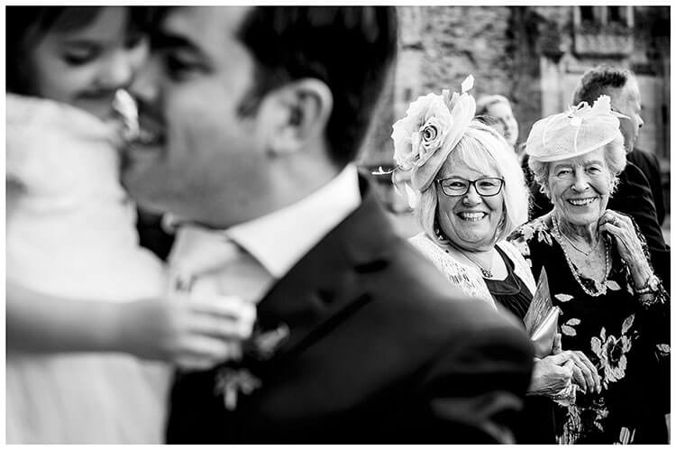 Two ladies enjoy the moment as father hugs his daughter at a Ramsey wedding favourite wedding photography 2018