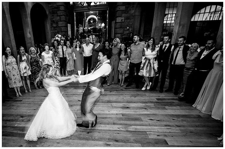 bride and groom spinning around on dance floor watched by guests during Chatsworth House wedding reception favourite wedding photography 2018