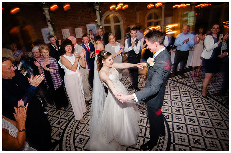 Smiling bride and groom during first dance at kilworth House watched by applauding guests favourite wedding photography 2018