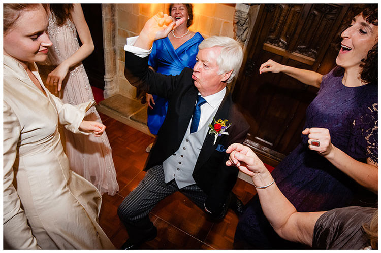 Gent striking a pose whilst dancing with the Bride at Smallfield Place Surrey weddig reception Favourite wedding photography 2018