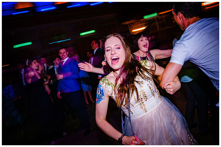 Lady enjoying being swung around the dance floor Kings College wedding reception Favourite wedding photography 2018