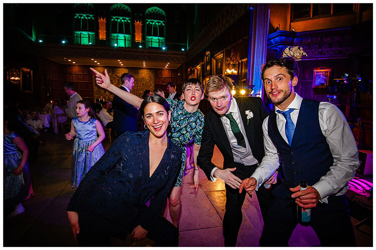 Group of wedding guests strike a pose whilst on the dance floor Kings College Cambridge favourite wedding photography 2018