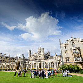 Favourite Wedding Venues - Bride & Groom with guests on lawn in front of St Johns College Cambridge enjoying drinks and conversation