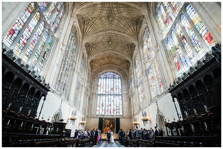 Bride & Groom walking down Aisle at Kings College one of Most popular wedding venues Cambridgeshire
