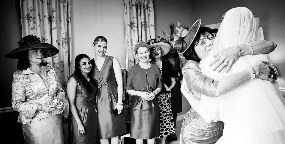 Creative Leicestershire Wedding Photographer Bride receives a big hug from grooms mum